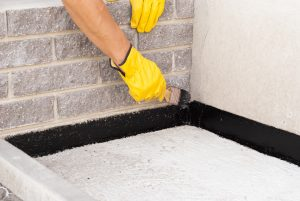 Guy water proofing wall