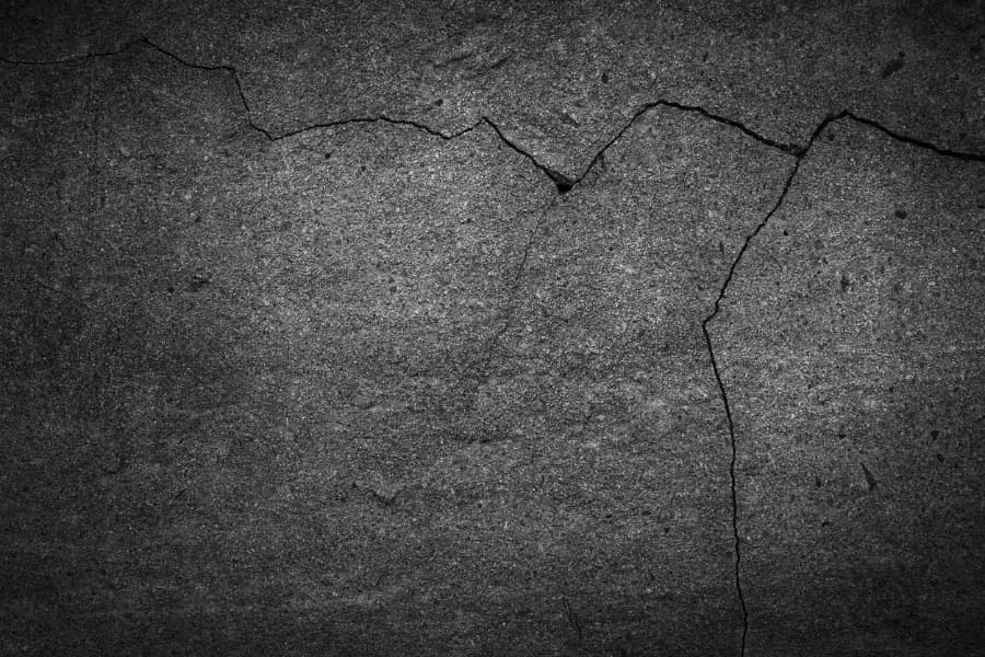 a large jagged crack on a cement floor